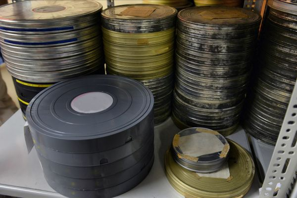 Picture of old films that need shrink wrap for protection.