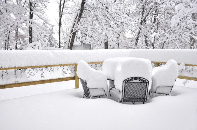 Image of outdoor patio furniture covered in two feet of snow